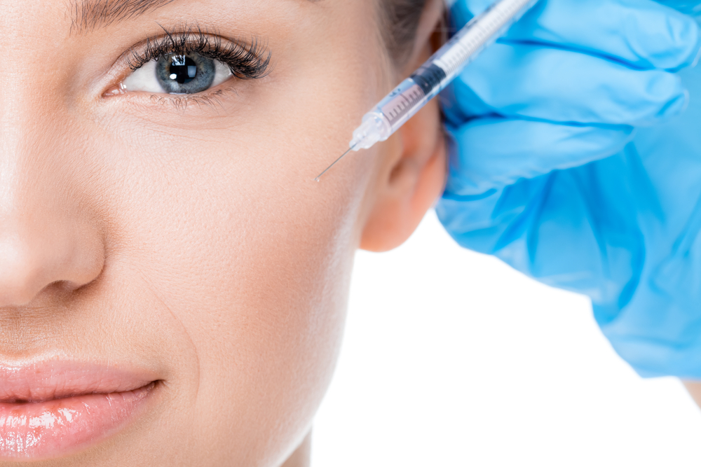 Woman Receiving Botox Injection for Face Wrinkles